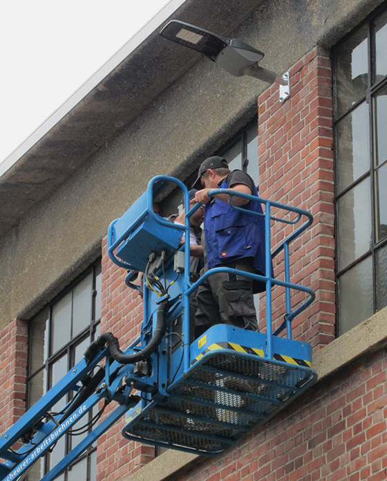 installing of one of the lamps on the building